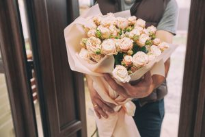 delivery-man-delivers-bouquet-beautiful-flowers-home